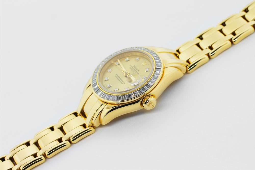 Rolex 18k Yellow Gold Masterpiece Full Factory Emerald Cut Diamond Bezel Factory Champagne Diamond Dial Model 69308 Complete with Box & Papers