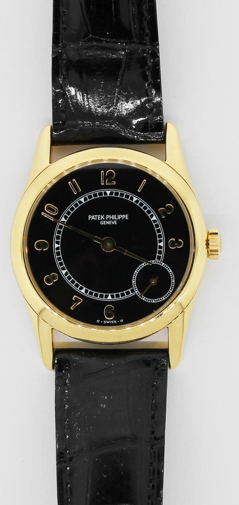 Patek Philippe 18k Yellow Gold Black Dial 5000J Calatrava with Booklets