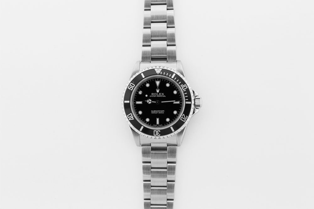 Rolex Steel Submariner 14060 with Box & Paper